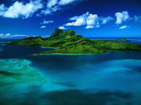 Small_island_in_ocean_and_mountain