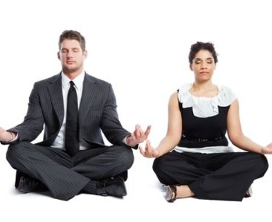 Medium executive couple meditating