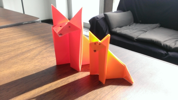 Carousel origami foxes side by side