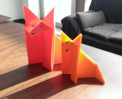 Medium origami foxes side by side