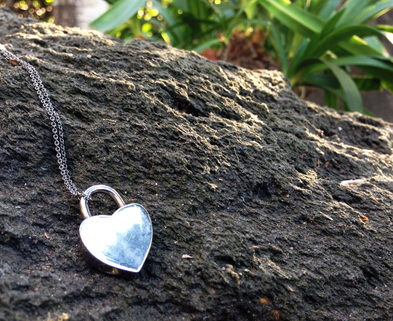 Medium heart locket on a rock
