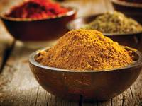 Small_turmeric-in-wooden-bowl
