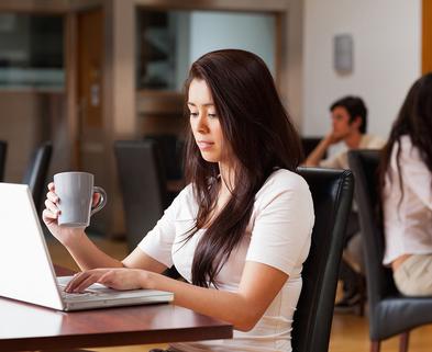Medium bigstock cute woman using a notebook in 23408711