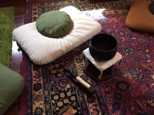Carousel meditation cushion and bell