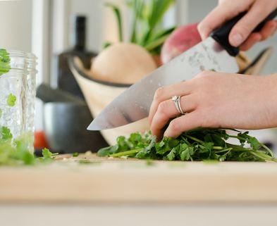 Medium chef chopping vegetables
