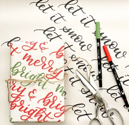 Carousel brush lettered gift wrapping class dabble the works seattle
