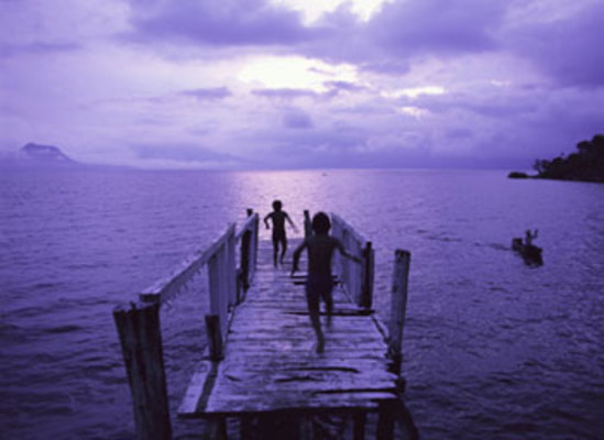 Carousel 2 kids on purple shaded pier to ocean