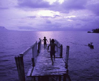 Medium 2 kids on purple shaded pier to ocean