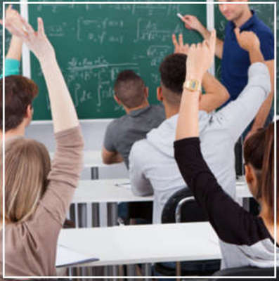 Carousel students rasing hands in class